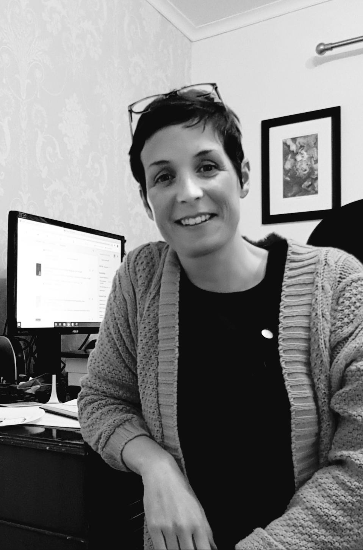 Dr Jane Masseglia at her desk